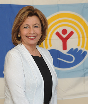 Connie Brown in front of the United Way Logo