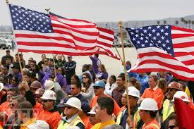 Union Workers in crowd holding american flag